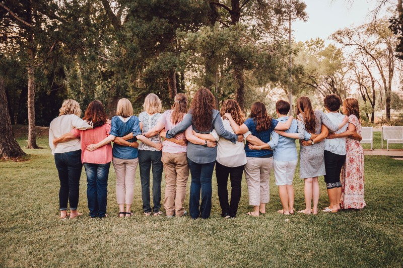 women with their arms around each other