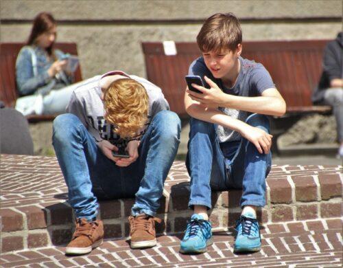 young men on phones
